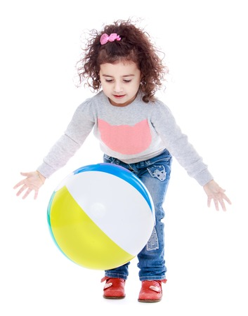 baby playing toy: Happy childhood, the family concept.Happy joyful little girl playing with a ball.Isolated on white.