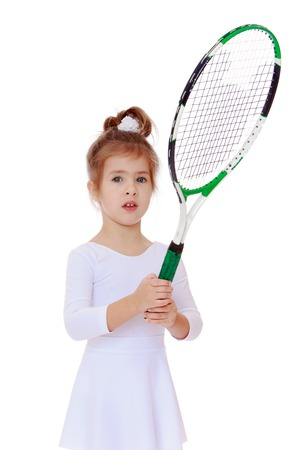 portrait of a three-year girl with a tennis racket in hand.Isolated on white. photo