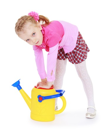industrious: Industrious little girl with garden watering can in his hand. Isolated on white.