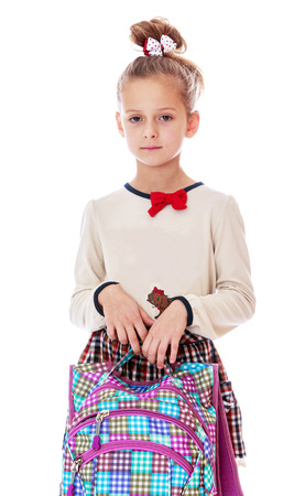 satchel: very serious little schoolgirl with satchel in hand. Isolated on white.