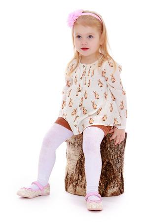 european white birch: elegant beautiful girl sitting on a stump - isolated on white. Stock Photo