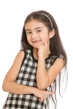 whose: charming smile adorable little girl whose teeth are changing - isolated on white. Stock Photo