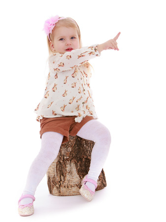 chock: Girl sitting on a wooden chock on a white background  - isolated on white background