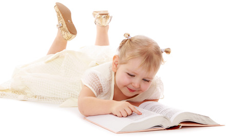 Little girl reading a book- isolated on white background photo