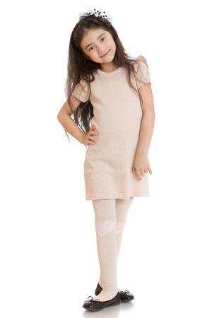 dark haired: Dark haired girl posing in dress beige - isolated on white background