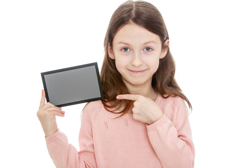 Little girl holding a gray card and shows a finger at her.- isolated on white background Stock Photo