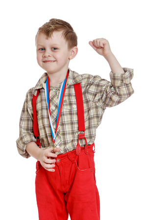 only the biceps: Funny little boy in red shorts with straps.- isolated on white background Stock Photo