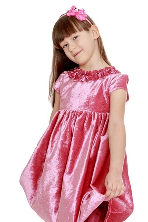 velvet dress: Portrait of little blond in red velvet dress- isolated on white background Stock Photo