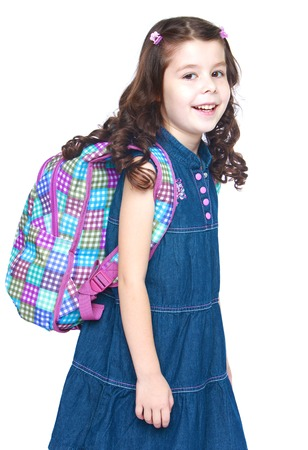 school girl: Beautiful dark-haired girl school girl with a school knapsack behind- isolated on white background