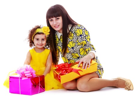 beautiful young family mother and daughter happy new year gifts isolated on white background stock