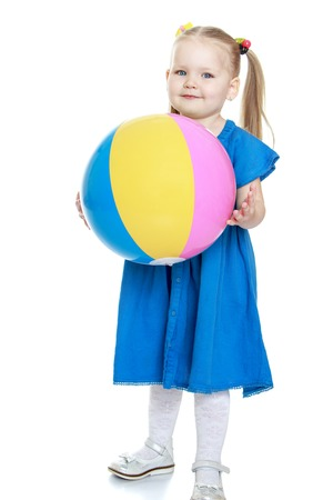 beach ball girl: Adorable chubby little girl in a beautiful blue dress holding a big ball-Isolated on white background