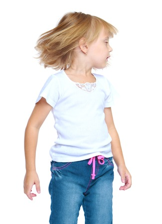 sharply: The little blonde girl turned her head sharply to the side-isolated on white background