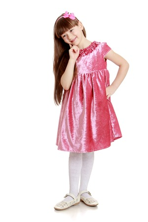 velvet dress: Stylish long-haired little girl in a red velvet dress and white stockings-isolated on white background Stock Photo