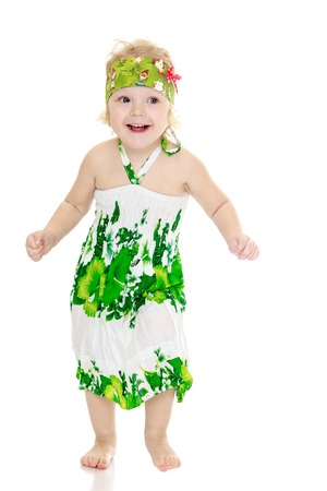 long feet: Very funny little girl with bare feet in a long summer dress-isolated on white background