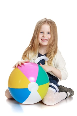 big ball: Beautiful long-haired blonde girl with a big ball in his hands-isolated on white background