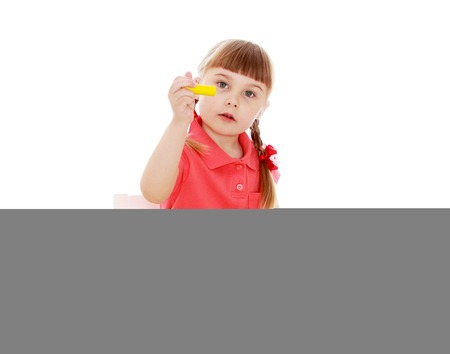 montessori: little girl working with the material in the Montessori kindergarten-Isolated on white background Stock Photo