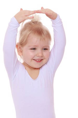 gymnastique: Petite gymnaste Mignon, close-up - isol� sur fond blanc
