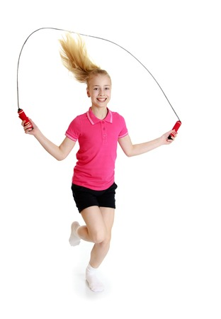 elementary kids: Teenage girl jumping rope - isolated on white background