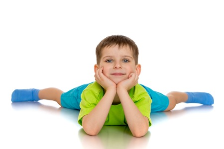 legs wide open: A little boy lies on the floor with their legs wide open - isolated on white background