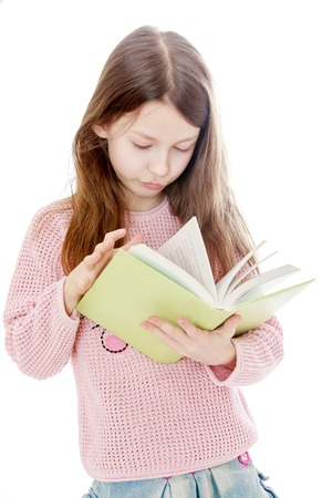 white book: Smart long-haired girl reading a book, close-up - isolated on white background
