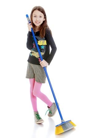 skinny girl: Charming skinny girl school girl sweeping floor brush - isolated on white background