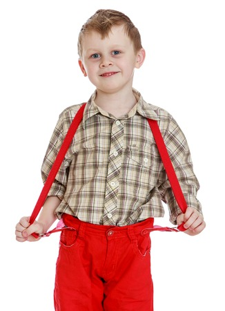red shorts: Little boy in red shorts with straps, close-up - isolated on white background