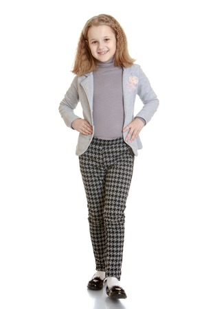 pantsuit: Elegant girl schoolgirl in a pantsuit - isolated on white background