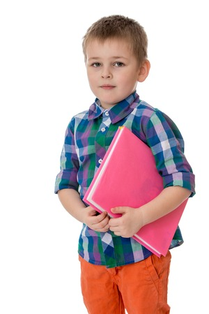 preparatory: Fair-haired little boy holding under his arm a thick book, he goes to a preparatory school - isolated on white background