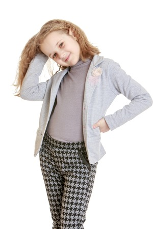 pantsuit: Stylish young blonde girl in a pantsuit moves his hands up her long hair - isolated on white background Stock Photo