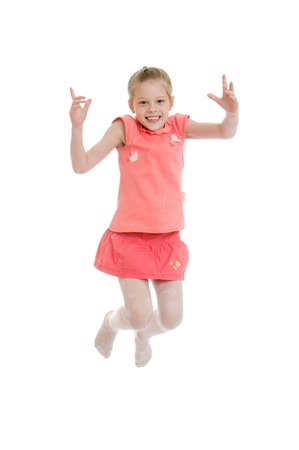 companions: Joyful blonde school girl in a pink shirt and short skirt high jumps companions hands-Isolated on white Stock Photo