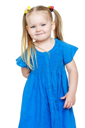 Adorable little round-faced girl with long blonde tails on the head-Isolated on white Stock Photo
