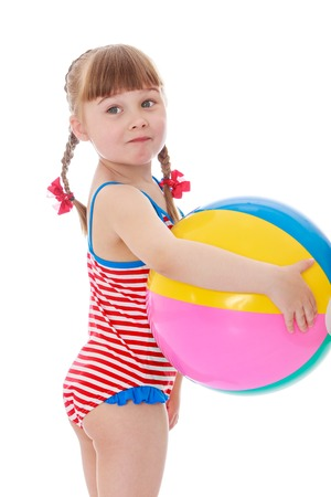 nude little girls: The little blonde girl with long braids on his head,in a striped swimsuit standing in sex trafficking holding a large inflatable striped ball , close-up , girl vacationing with his parents at the resort-Isolated on white Stock Photo