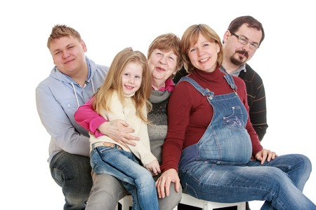 love very: Big happy family grandmother , a pregnant mother, father, older brother and younger sister are all very happy to be together they love each other , only five people-Isolated on white Stock Photo
