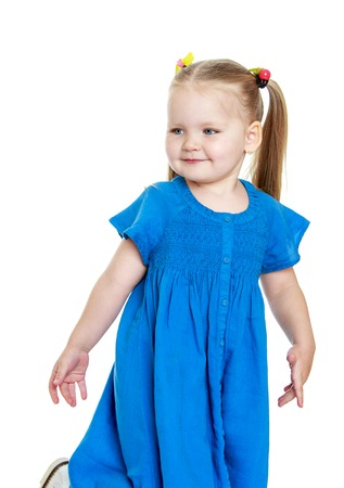 Adorable little round-faced girl with long tails on the head in a long blue dress, close-up-Isolated on white background