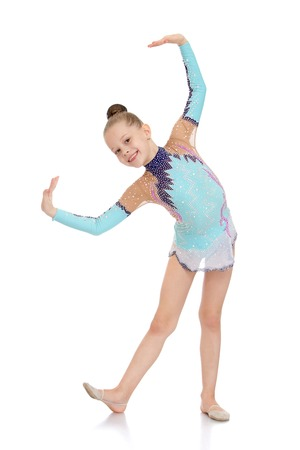 little girl dancing: Beautiful young gymnast in a bright tracksuit sports shows exercises-Isolated on white background