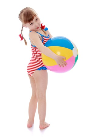 beach ball girl: Beautiful little blonde girl with short hair and long braids on her head in a striped swimsuit holding hands beach ball, girl vacationing with his parents at sea-Isolated on white background