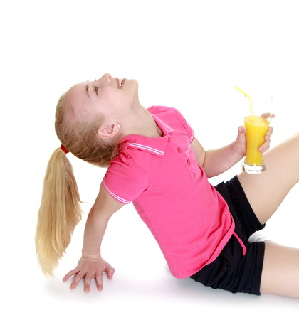 blonde teenage girl: blonde teenage girl with very long fluffy tail on her head in a pink t-shirt and shorts is sitting on the floor