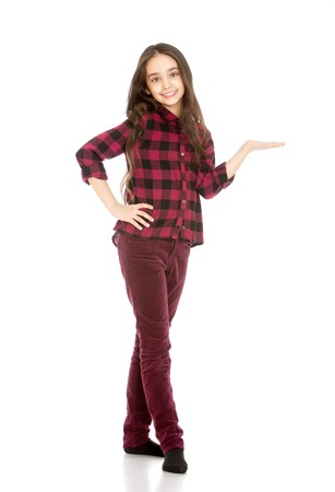 skinny jeans: Beautiful, slender young girl Oriental appearance with long dark hair in corduroy skinny jeans and a plaid shirt features a hand towards-Isolated on white background