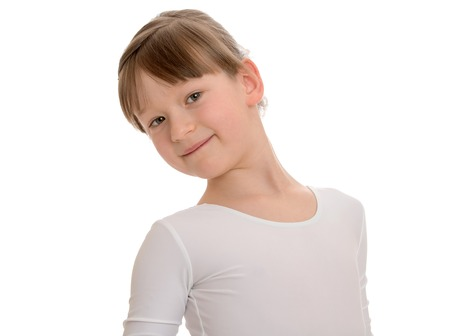 beautiful bangs: beautiful little athlete with short bangs in a white sports swimsuit