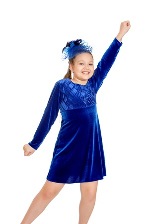 velvet dress: Smiling blond girl with pigtails on her head in a hat with netting and a long blue velvet dress. Girl Otrokovice waving his hands , close-up Stock Photo