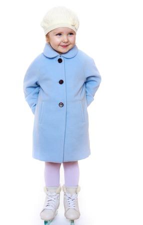 drab: Adorable little blonde girl figure skater dressed in drab blue coat