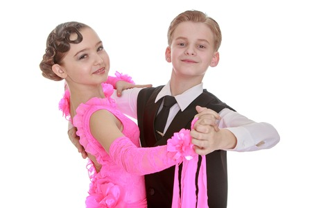 Beautiful youth dance couple. the girl is dressed in a long pink dress and a young man in a black three . Both of them holding hands and looking at the camera-Isolated on white background