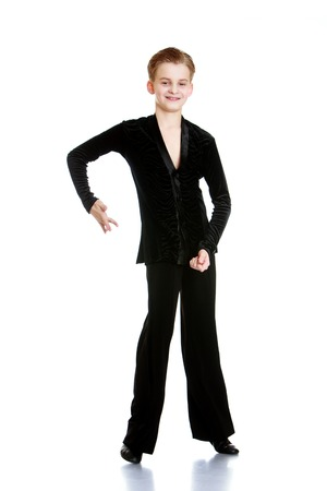 plasticity: Boy dancer in a black dresser shows off her plasticity . The boy has long been involved in dance at school , he often travels to competitions with his partner and their parents-Isolated on white background Stock Photo