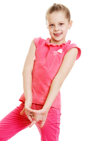 pantsuit: Adorable blonde teen girl in a pink pantsuit . Closeup-Isolated on white background Stock Photo