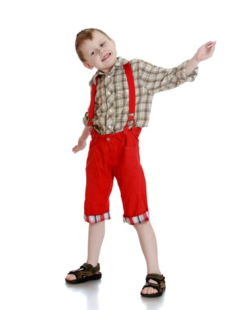red shorts: small blond boy in a long red shorts waving his hands-Isolated on white background