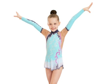 swimming costumes: Beautiful slender little girl gymnast in the sport bathing suit does exercises-Isolated on white background Stock Photo