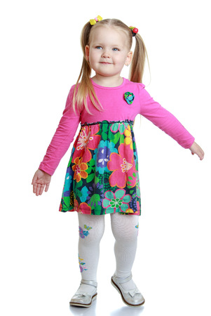 gray eyes: Adorable little blonde girl with gray eyes in a short colorful dress-Isolated on white background