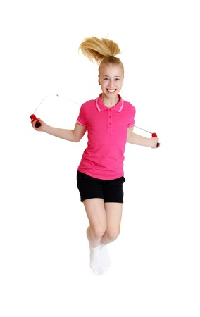 gray eyes: Beautiful blond girl with gray eyes jumping rope. The girl wearing the pink Jersey with short sleeves and short black shorts-Isolated on white background
