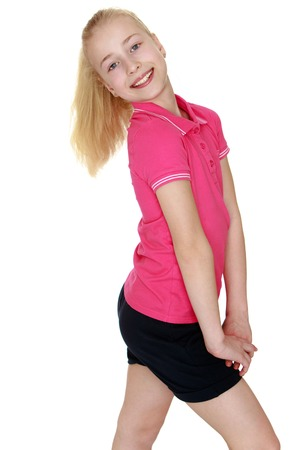 gray eyes: Beautiful blond girl with gray eyes turned sideways to the camera. The girl wearing the pink Jersey with short sleeves and short black shorts . closeup-Isolated on white background