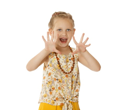 gray eyes: Beautiful little girl with gray eyes and blonde hair in a fashionable suit. Neck girls long amber necklace. she fidgets with hands-Isolated on white background Stock Photo